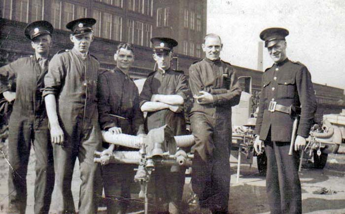 Members of the Auxiliary Fire Service in Farnworth during WW2. Billy Berry is centre with the hat and Arthur Stafford is to his left.